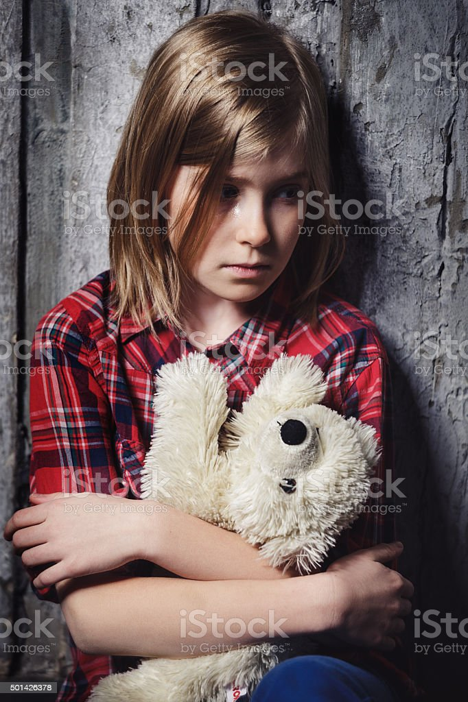 Depressed child with toy stock photo