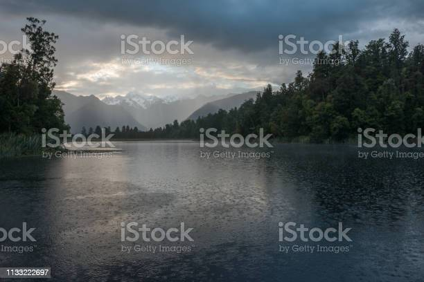 Photo of Depressed cloudscape and strong rain over the Lake Matheson