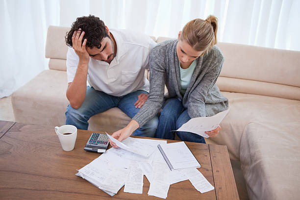 depressed couple doing their accounting - money bills and currency stock pictures, royalty-free photos & images