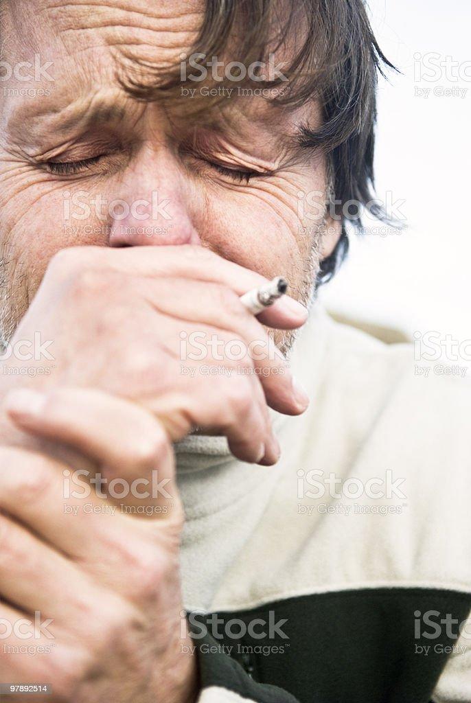 depressed crying man smoking cigarette royalty-free stock photo