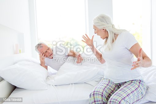 istock Depressed, discomfort, problem in relationship concept. Rage woman in pajama, sleep, wear yelling at a man gesticulating. Concept of quarrels and scandals, difficult situation in relations 1049799468