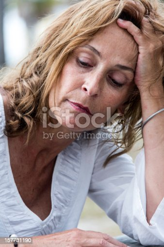 istock Depressed fifty something woman 157731190