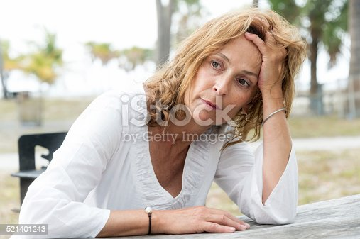 istock Depressed fifty something woman 521401243