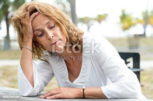 istock Depressed fifty something woman 586358258