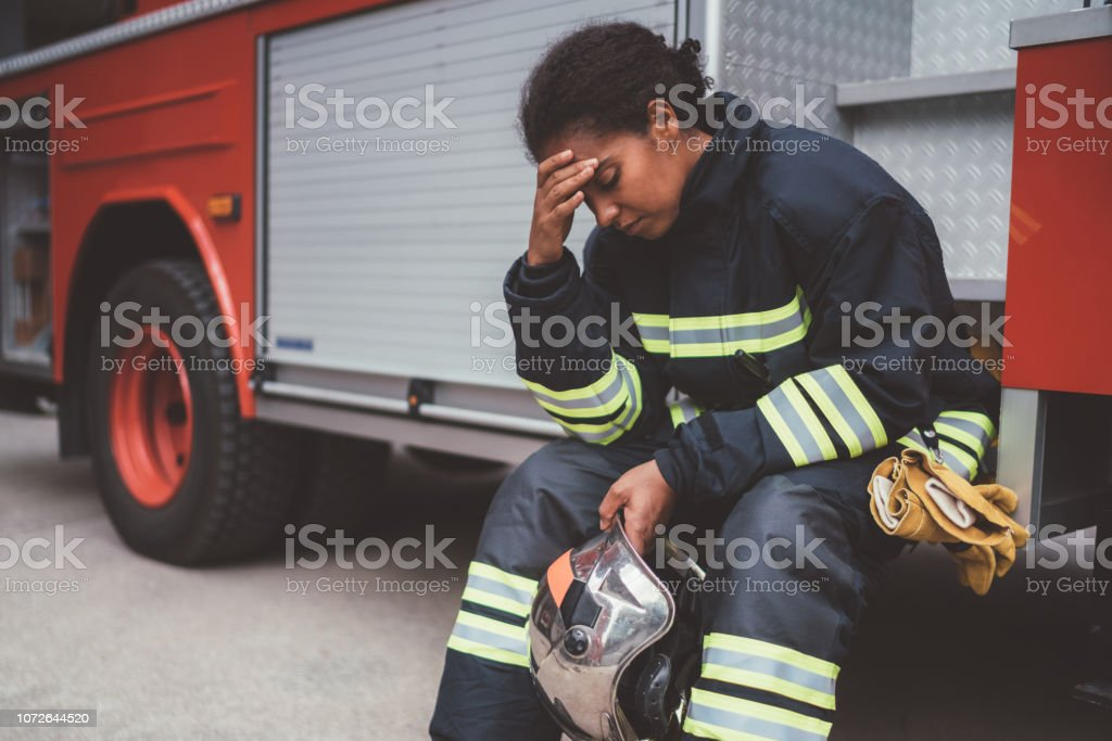 Depressed firefighter after rescue operation stock photo