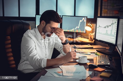 istock Depressed frustrated trader tired of overwork or stressed by bankruptcy 1130771131