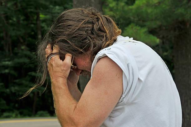 Depressed Hippie Man stock photo