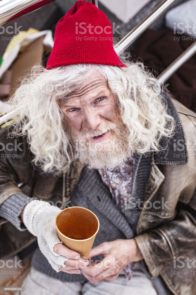 Depressed homeless man looking at you royalty-free stock photo