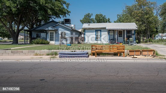 Hobbs, New Mexico, USA - September 07, 2017:  The small city of Hobbs contains a number of depressed dwellings.  This is often contributed to the boom and bust cycle of the oil industry.  Pictured here are the front facades of single family units.