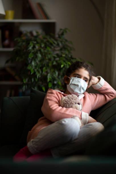 Depressed kid during epidemic quarantine stock photo
