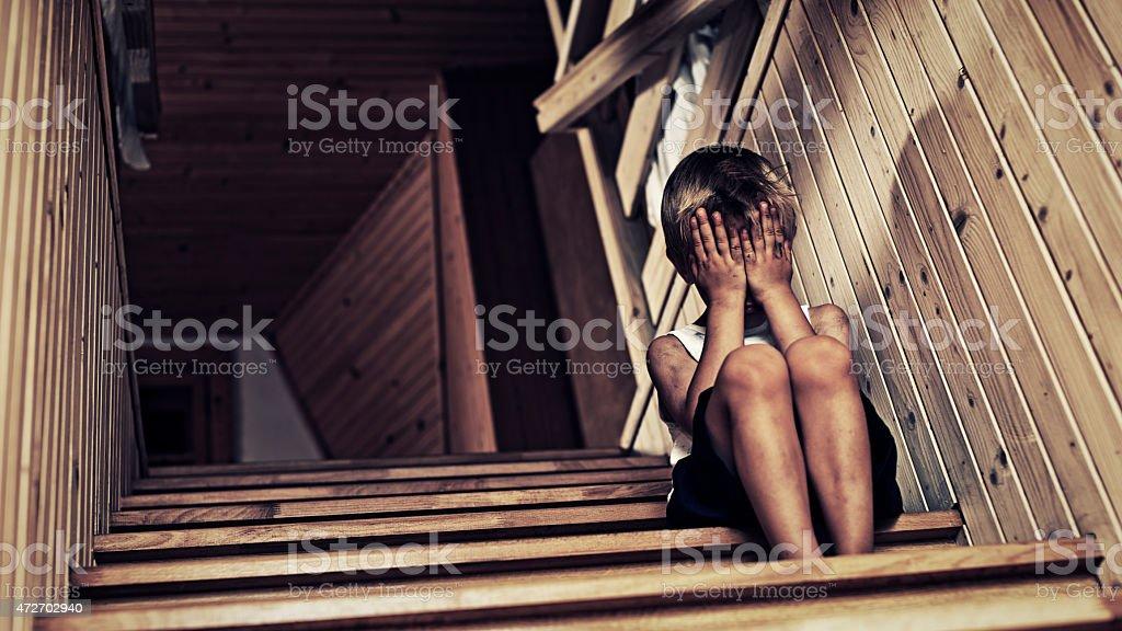 Depressed little boy crying. royalty-free stock photo