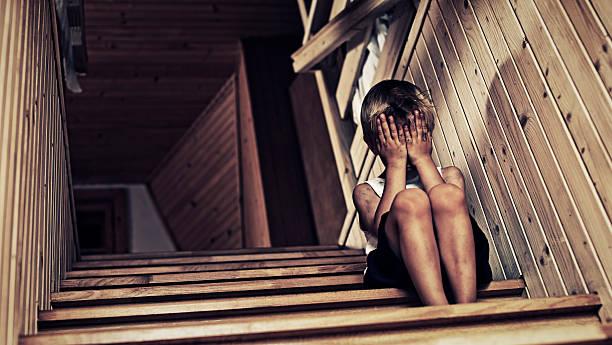 Depressed little boy crying. stock photo