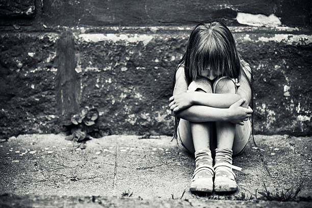 depressed little girl - homelessness stock photos and pictures