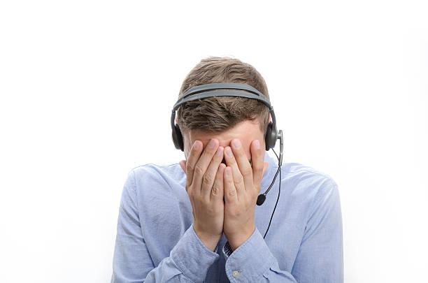 Depressed Male Callcenter Agent stock photo
