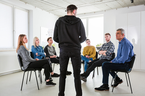 Depressed Male Sharing Problems During Meeting Stock Photo - Download Image Now