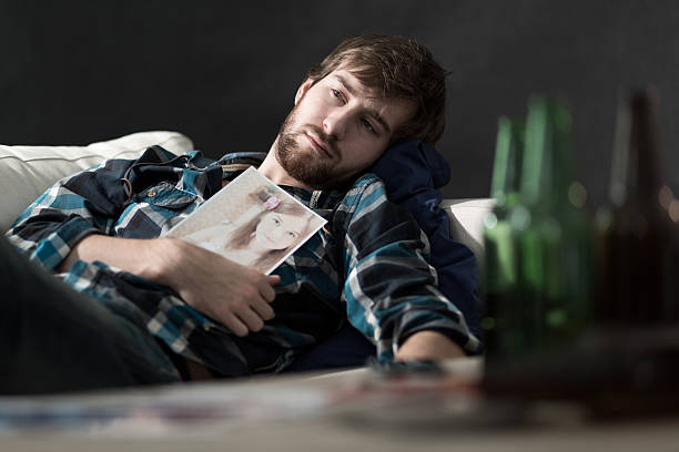Depressed man after split up Depressed man drinking beers after split up former stock pictures, royalty-free photos & images