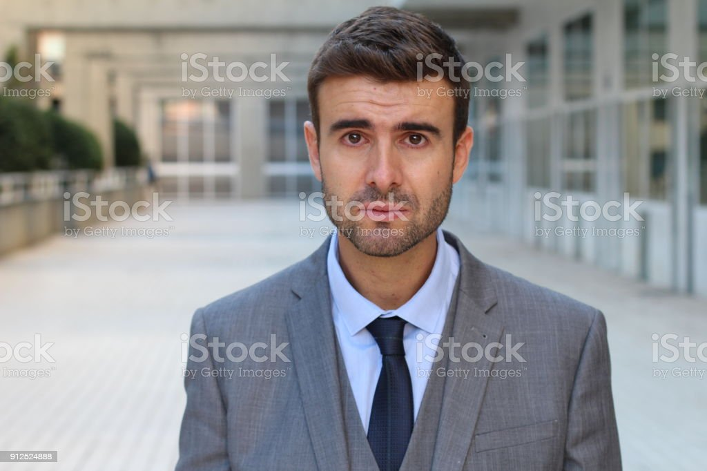 Depressed man crying a river stock photo