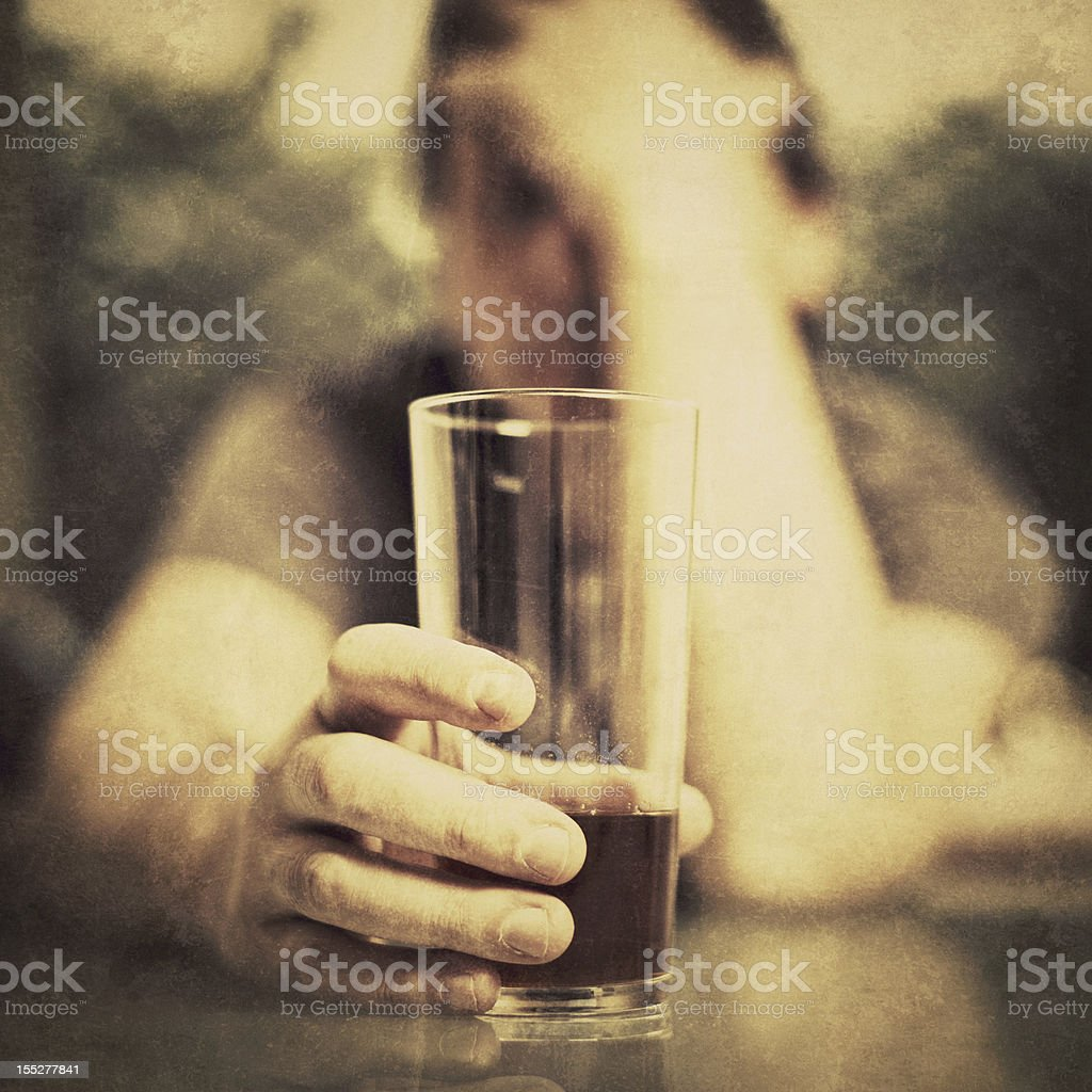 Depressed Man Drinking Alcohol stock photo