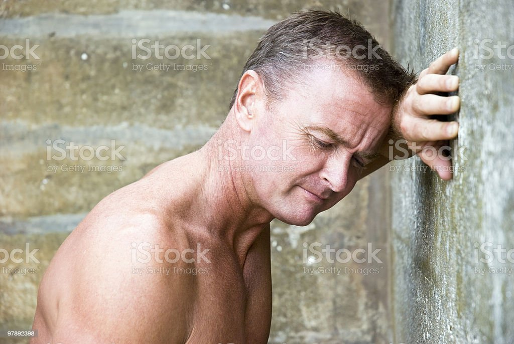 Depressed man leaning against wall. royalty-free stock photo