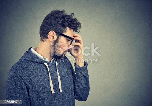 istock Depressed man pondering on problem 1076354712