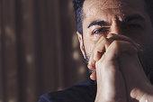istock Depressed man praying, crying 1055635450
