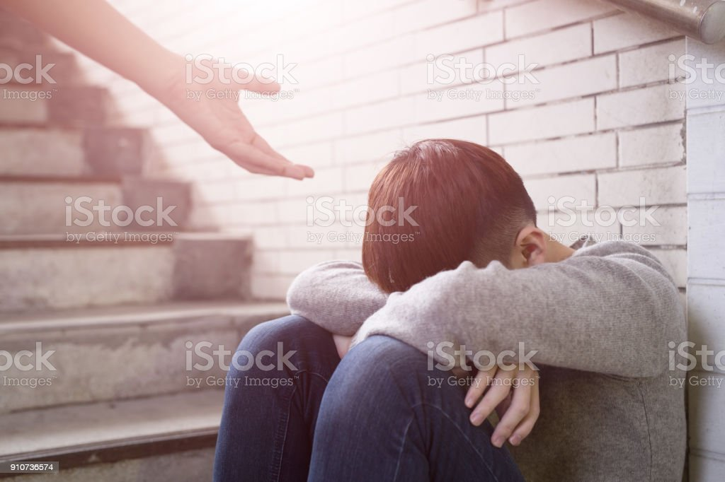 depressed man sit in underground stock photo