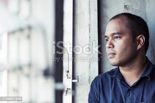 depressed man sitting in dark room