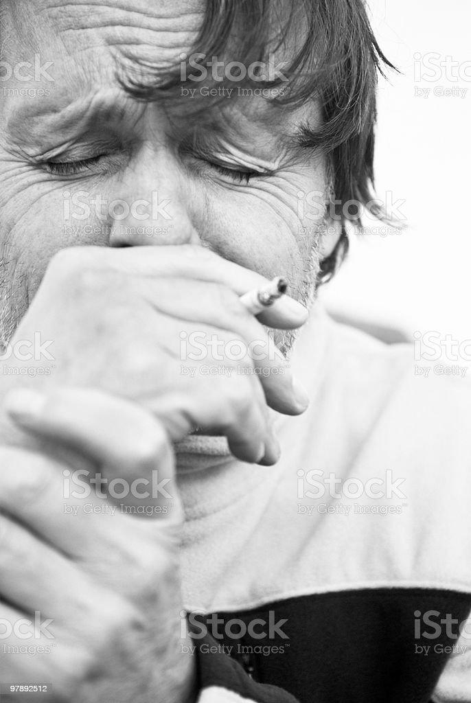 depressed man smoking cigarette. royalty-free stock photo