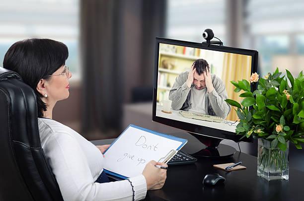 Depressed man visits to virtual psychotherapist stock photo