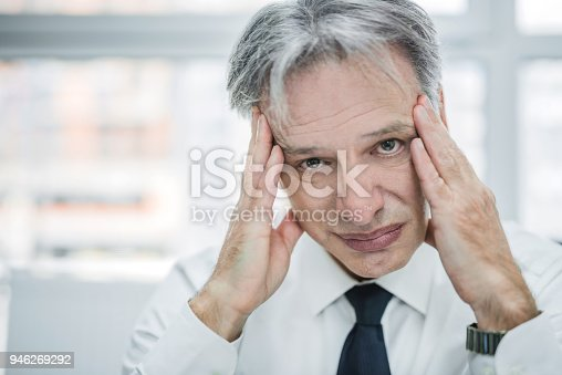 istock Depressed mature man can't stand work anymore. 946269292
