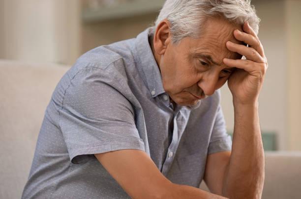 depressed senior man at home - old man foto e immagini stock