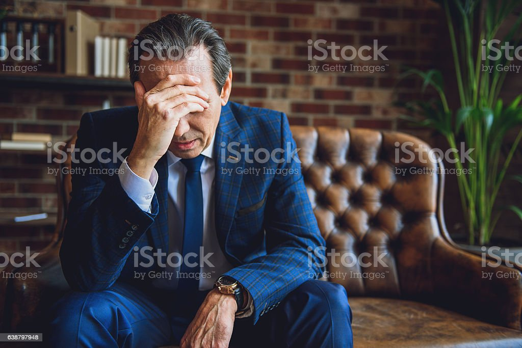 Depressed senior man having troubles stock photo