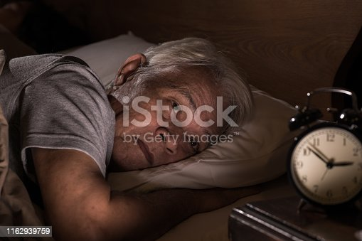 istock A depressed senior man lying in bed cannot sleep from insomnia 1162939759