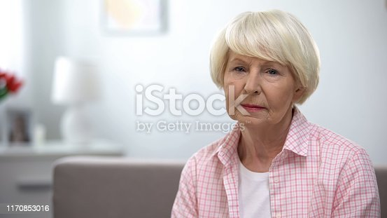 Depressed senior woman looking at camera, social insecurity, low incomes
