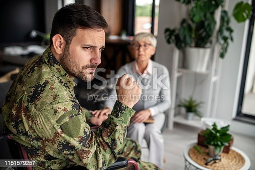 istock Depressed soldier and his psychotherapist during a session 1151579257