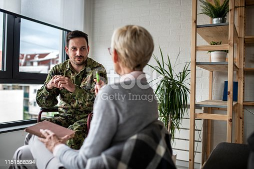 istock Depressed soldier and his psychotherapist during a session 1151588394