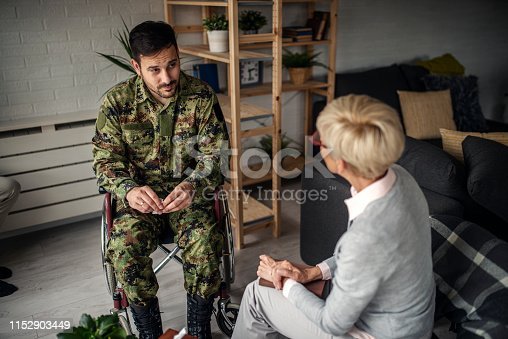 istock Depressed soldier and his psychotherapist during a session 1152903449