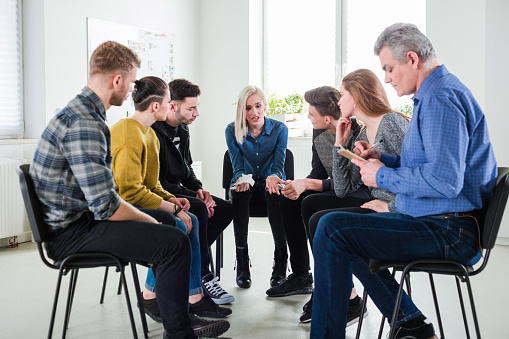 Depressed Student Sharing Problems During Meeting Stock Photo - Download Image Now