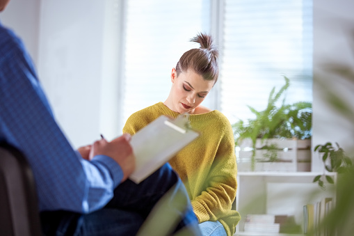 Depressed Student With Mental Health Professional Stock Photo - Download Image Now