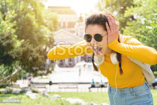 Depressed teen  closing ears and screaming