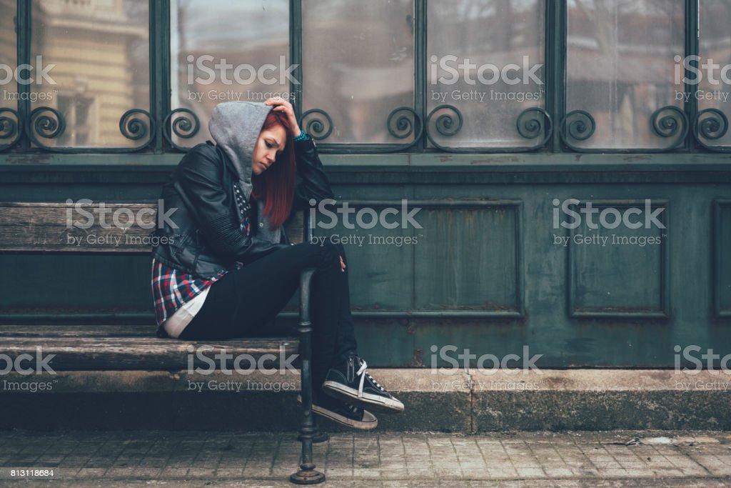 Depressed teenage girl outside stock photo