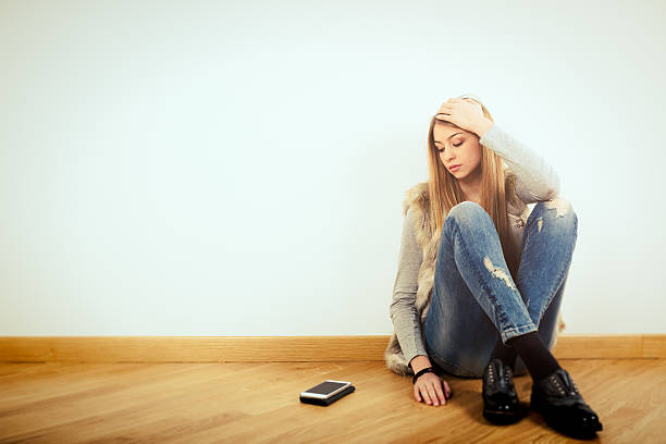 depressed teenage girl - smartphone addiction not groups stock pictures, royalty-free photos & images