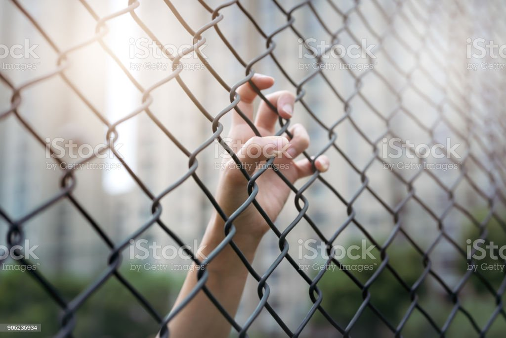 Depressed, trouble and solution. Women hand on chain-link fence. royalty-free stock photo