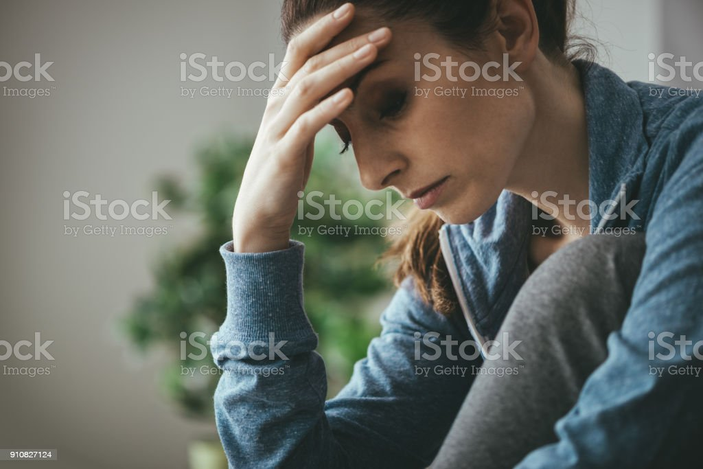 Depressed woman at home royalty-free stock photo