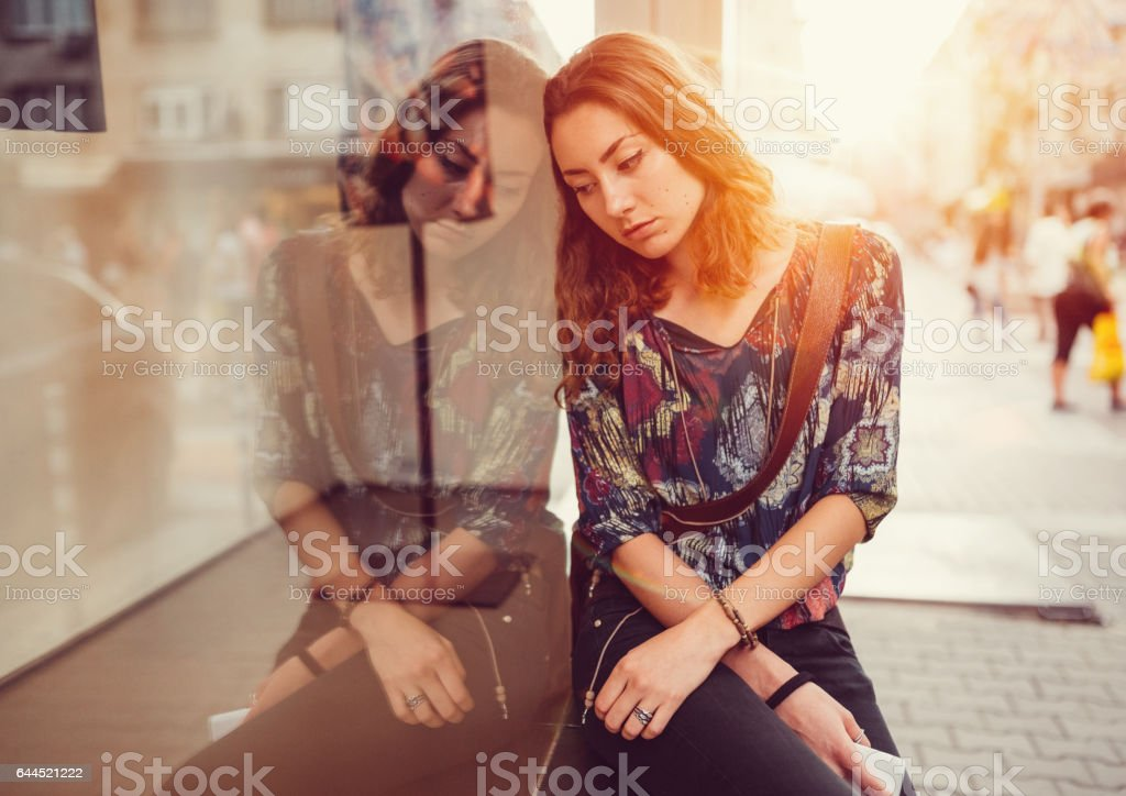 Depressed woman at the street stock photo