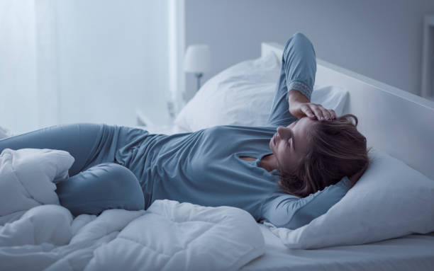depressed woman awake in the night - exhaustion stock pictures, royalty-free photos & images
