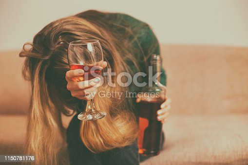 istock Depressed woman drinking alcohol 1150781176