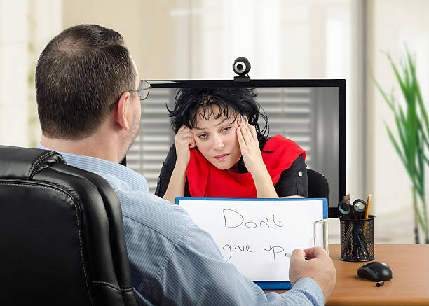 Depressed woman has shrink appointment online stock photo