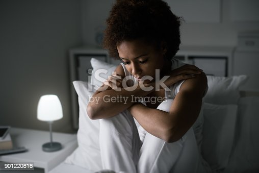 istock Depressed woman in her bed 901220818