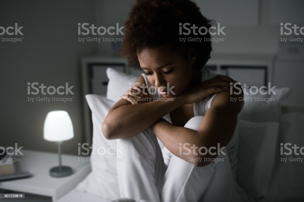Depressed woman in her bed stock photo